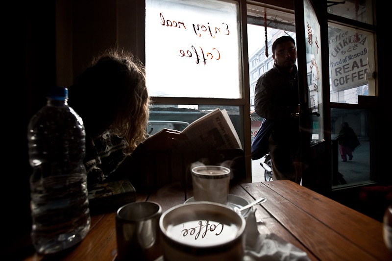 Guy reading a paper and sipping some real joe at Kathmandu's Coffee Chikusa